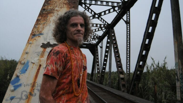 Tem Noon standing in front of a train tressel in Ventura California.